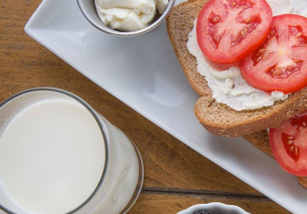 Ricotta cheese and Roma tomatoes on toast with milk for an easy breakfast.