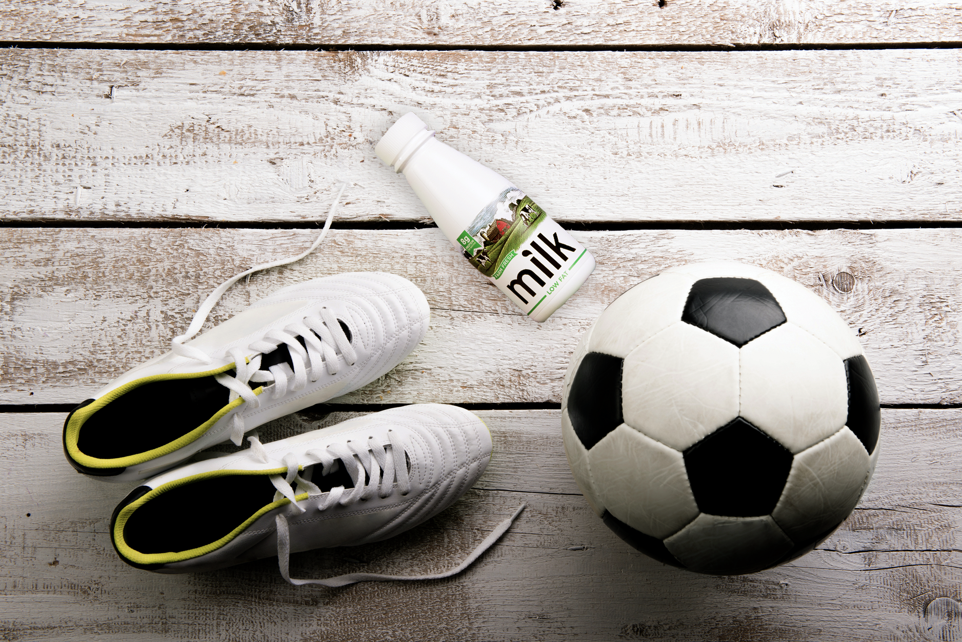 Cleats, soccer ball and milk.