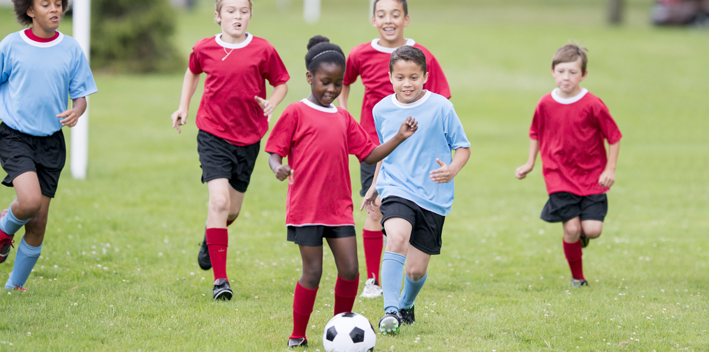 Youth soccer players on a field