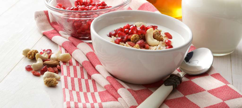 A bowl of muesli with pomegranates
